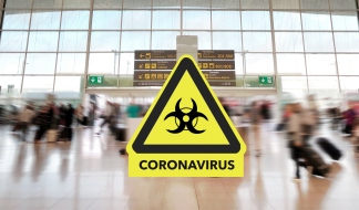 Airport terminal and coronavirus sign